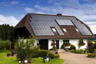 a-construction-for-a-private-house-with-a-lot-of-solar-panels-on-roof-as-the-source-of-natural-energy